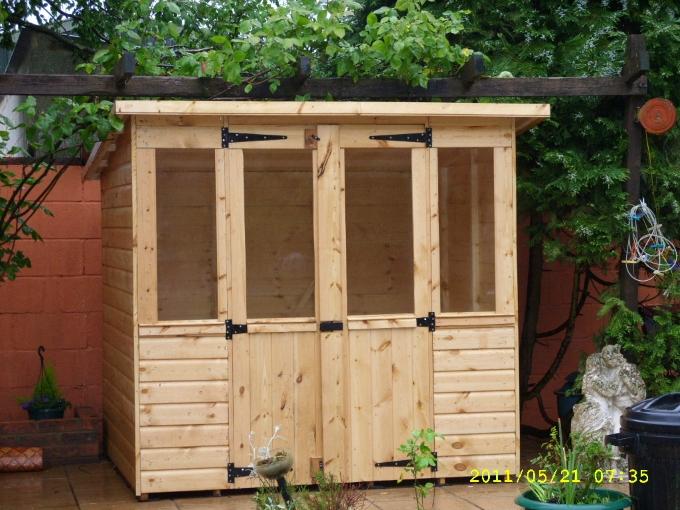 Prefab garage kits wood cabin plans michigan sheds cheap for Cheap 2 car garage kits